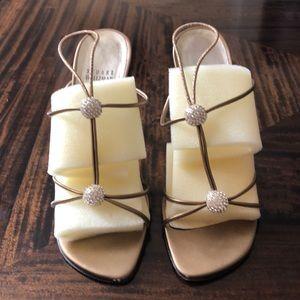 Stuart Weitzman Trixie brass kid sandals.